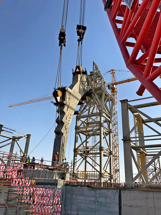 The first precast element successfully installed in a tandem lift using two 600-tonnes crawler cranes.